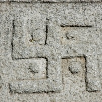 Carving of a Tibetan swastika